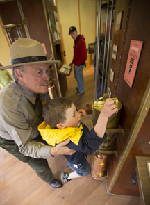 Steve Iobst helping child reach coin slot